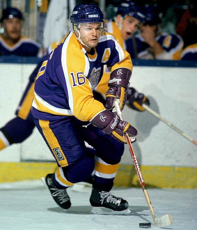 "Marcel Dionne may be the best NHL player who never won Lord Stanley's Cup. After arriving from Detroit in a 1971 trade, he spent 12 seasons with the Kings, compiling 550 goals and 757 assists for 1,307 points, good for the top spot on the franchise's all-time scoring list. With wingers Charlie Simmer and Dave Taylor, the eight-time All-Star was the backbone of the famed ""Triple Crown Line"", one of the most dangerous scoring units in the history of the game. Dionne won the NHL scoring title for 1979-80 and was a two-time recipient of the Lady Byng Trophy for gentlemanly play. The Kings retired his number 16 on November 8, 1990, two years before his induction into the Hockey Hall of Fame."