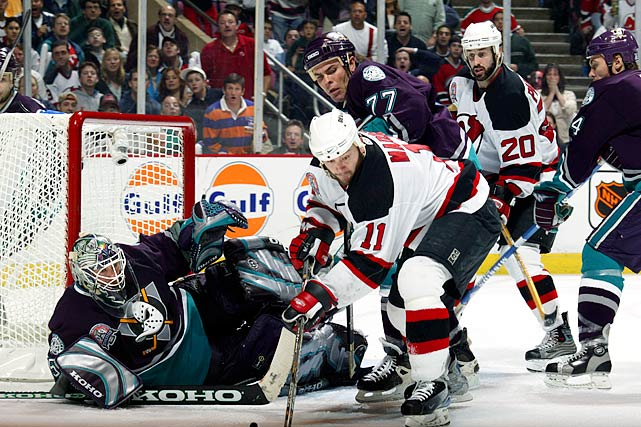 Jean-Sebastien Giguere earned Conn Smythe honors for his stellar goaltending that carried the seventh-seeded Mighty Ducks (40-27-9-6) to the franchise's first Stanley Cup Final appearance. In the first round, they swept second-seeded Detroit in a series that included two triple-overtime thrillers. Then they opened their second-round match-up with top-seeded Dallas by winning a 5-OT marathon, 5-4. After eliminating the Stars in six, the Ducks swept the upstart Wild (6), who were making their first-ever playoff appearance, with Giguere posting a pair of shutouts. The Cup final against the Devils (2) went seven, but New Jersey prevailed thanks to Martin Brodeur, who dumped three buckets of whitewash on the Ducks.