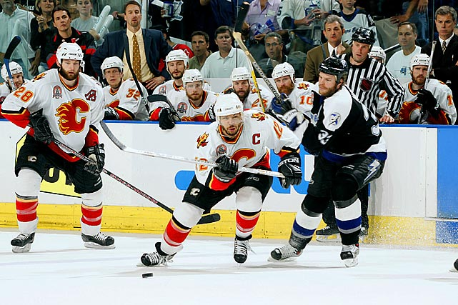 Jarome Iginla and the sixth-seeded Flames (42-30-7-3) came out of West after going the distance with the Canucks (3), beating the top-seeded defending Cup champion Red Wings in six, and dispatching the Sharks (2) in six. In the final, Calgary grabbed a three-games-to-two lead on Tampa Bay, the East's top seed, but lost Game 6 in double overtime when Martin St. Louis beat Flames netminder Miikka Kiprusoff. Game 7 was a 2-1 nailbiter won by the Lightning on a pair of Ruslan Fedotenko goals.