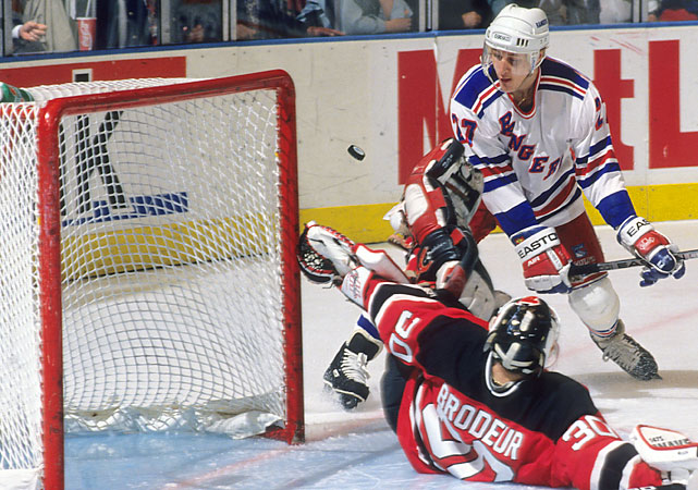 """Nicholls made up for lost time with two goals -- one shorthanded and one power-play -- to put the Devils on the verge of their first Stanley Cup Final. The rookie Brodeur made 25 saves. """"I'm sure they're gaining a tremendous amount of confidence from him, as has been the case in the history of the league a la Patrick Roy last year,"""" Rangers coach Mike Keenan said of Brodeur, according to the Boston Globe."""