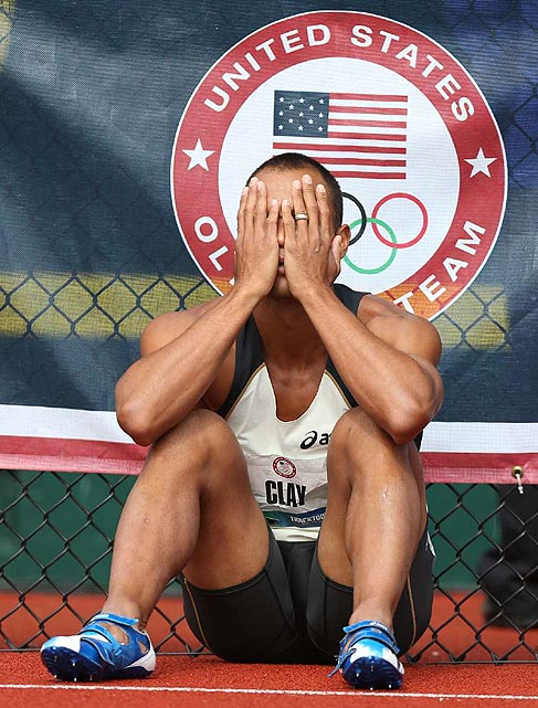 Two-time Olympian Bryan Clay buries his head in his hands after a DQ on the hurdles ensured he would not make the 2012 team. He was looking to become the first Olympian ever to win a decathlon medal in three straight Games.