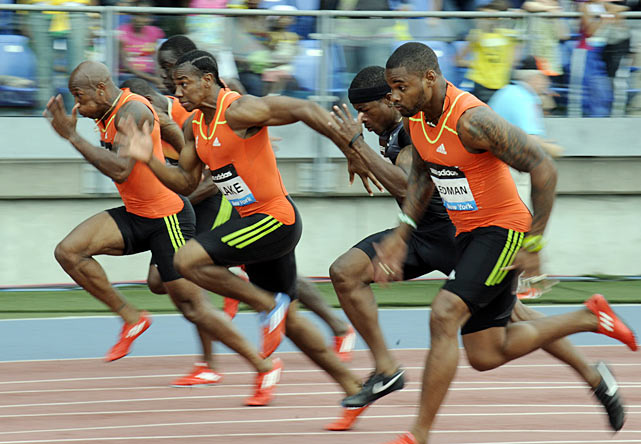 Yohan Blake and the rest of the men's 100 meters field takes off at the start.