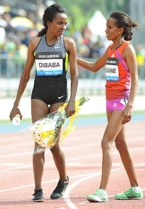 After winning the women's 5000 meters, Ethiopia's Tirunesh Dibaba is congratulated by fellow Ethiopian Werknesh Kidane.