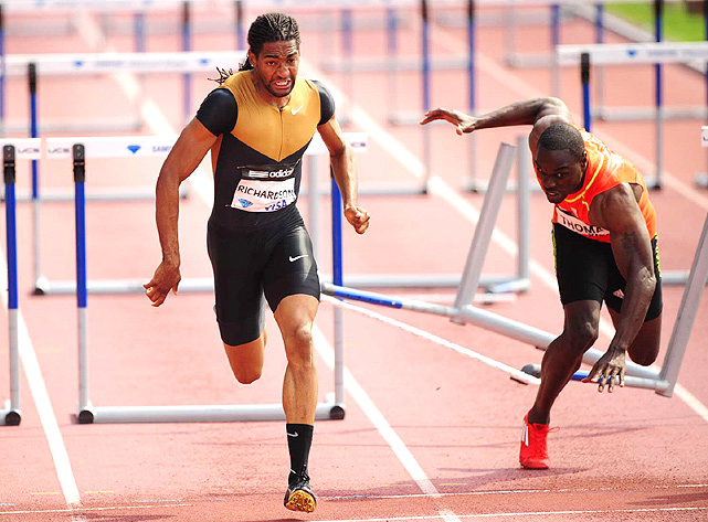 On the last hurdle, Jason Richardson avoided his stumbling opponent Dwight Thomas en route to winning the men's 110 meter hurdles.