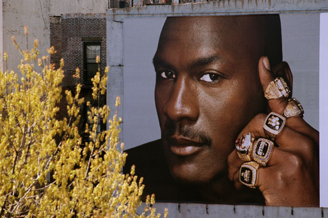 Michael Jordan showcases his six championship rings to E. 125th street in Harlem.
