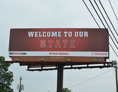 North Carolina State took its in-state rivalry with the University of North Carolina to new heights this week when it unveiled several billboards declaring the Tar Heel State to be Wolfpack territory.