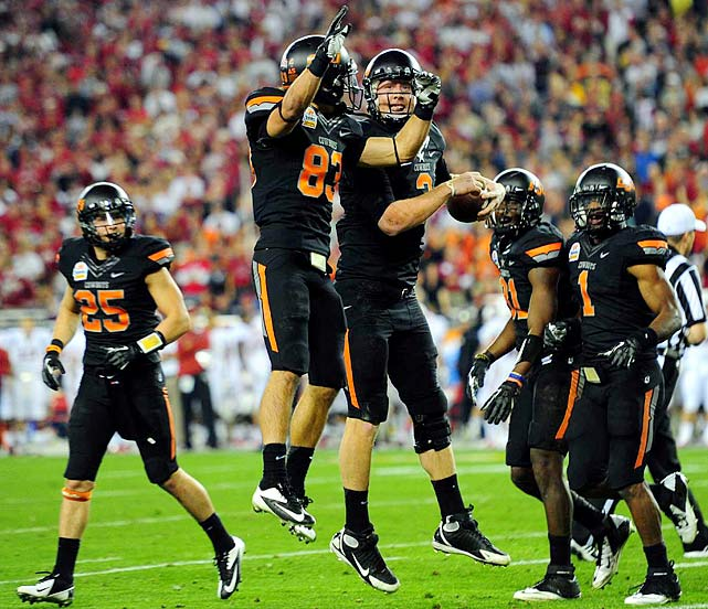 The Cowboys had their best season in program history, but a hiccup in Ames, Iowa, kept them out of the BCS national championship -- even though the two qualifiers had played each other once already. Brandon Weeden and Justin Blackmon carried the Cowboys to a thrilling 41-38 victory over Stanford in the Fiesta Bowl, but an ugly title game between LSU and Alabama left the Cowboys and all fans wondering how Oklahoma State could have tested the Tide's tough, brutish defense.