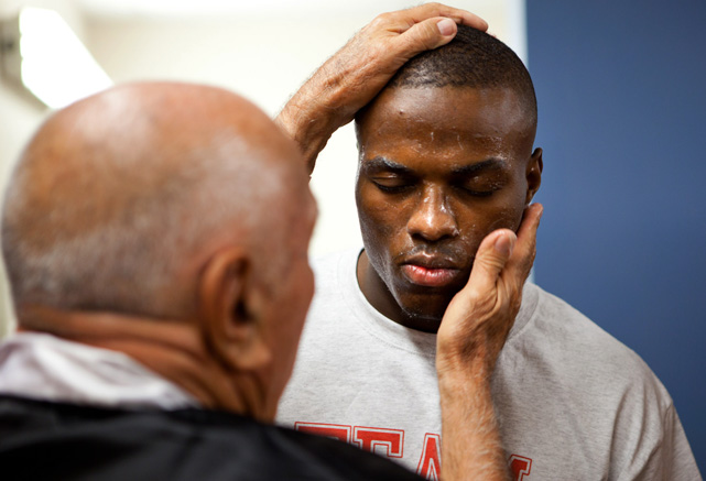 Cutman Joe Chavez applies Vaseline to Quillin. The viscous substance helps prevent cuts by making the opponent's glove slide off the angles of the face.
