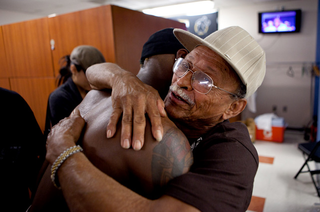 Quillin and his father embrace in the dressing room after the win, which raises the young contender's professional record to 27-0 and could put him in line for a title shot before the end of the year.