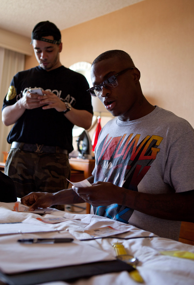 Back at the hotel, Quillin organizes the tickets for 15 friends and family members. He is comped a given amount by the promoter, but has to pay for the rest himself.