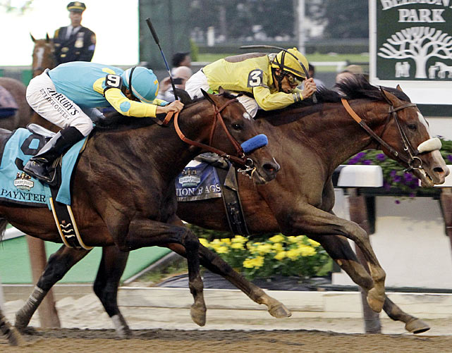 It was another photo finish decided by a neck. Just like the Preakness.