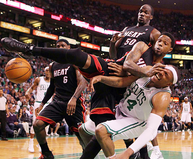 A couple of Miami Heat players fall on top of the Boston Celtics' Paul Pierce during Game 4 of the Eastern Conference Finals.