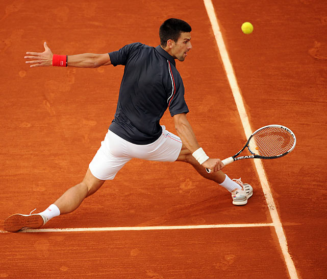 Novak Djokovic makes a play on the ball in his third-round match at the French Open -- Djokovic defeated Nicolas Devilder 6-1, 6-2, 6-2.