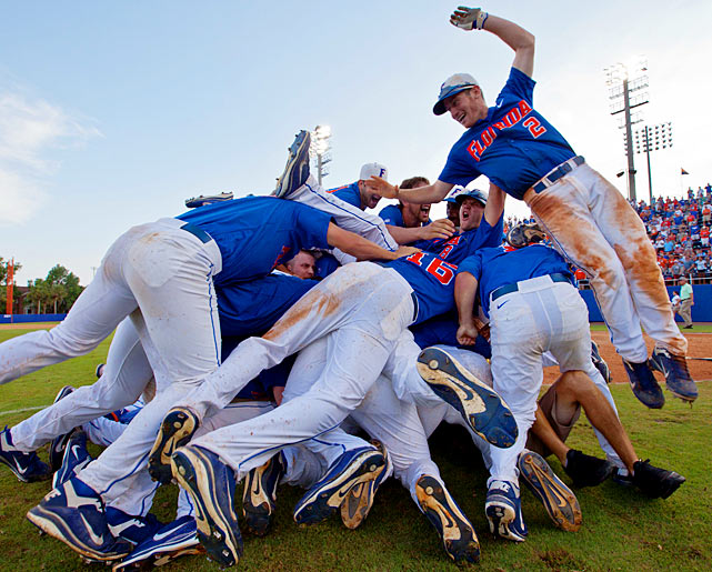 Florida infielder Casey Turgeon finishes the dog pile after the No. 1 Gators beat N.C. State 9-8 in an extra-inning thriller to advance to the College World Series. Still without a College World Series championship, Florida is heading to Omaha for the eighth time in program history and for the third consecutive season.
