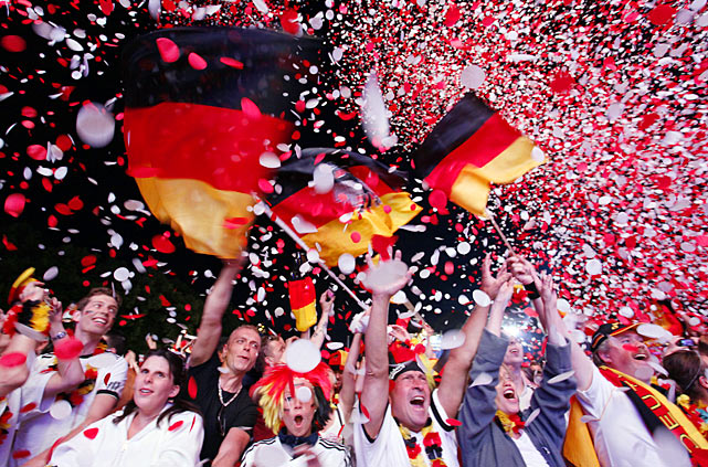 German national team supporters cheer at a public screening after Germany's 1-0 victory over Portugal in Euro 2012.