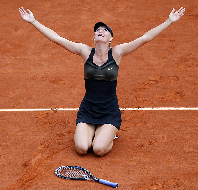 Maria Sharapova celebrates her 6-3, 6-2, French Open final victory over Italy's Sara Errani. Sharapova has now won each grand slam tournament once in her career.