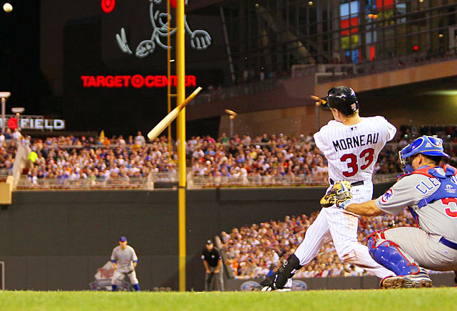 Justin Morneau of the Minnesota Twins breaks his bat against the Cubs. The Twins defeated the Cubs 8-7 on Friday.