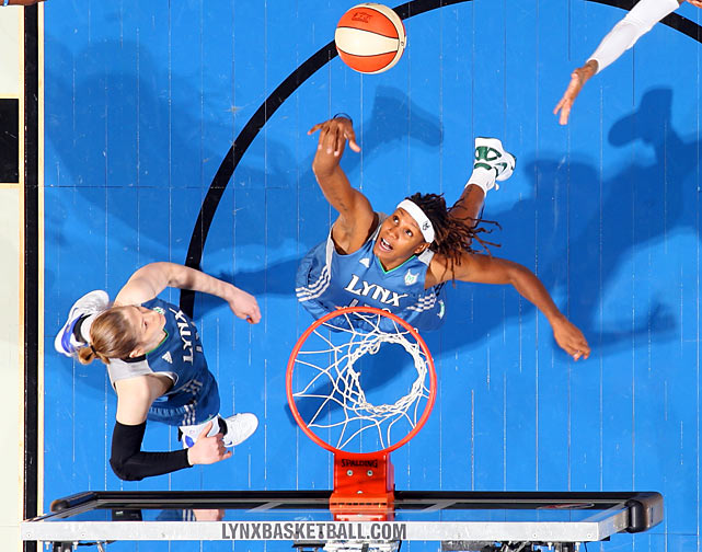 Rebekkah Brunson (32) of the Minnesota Lynx skies for a rebound against the Chicago Sky.