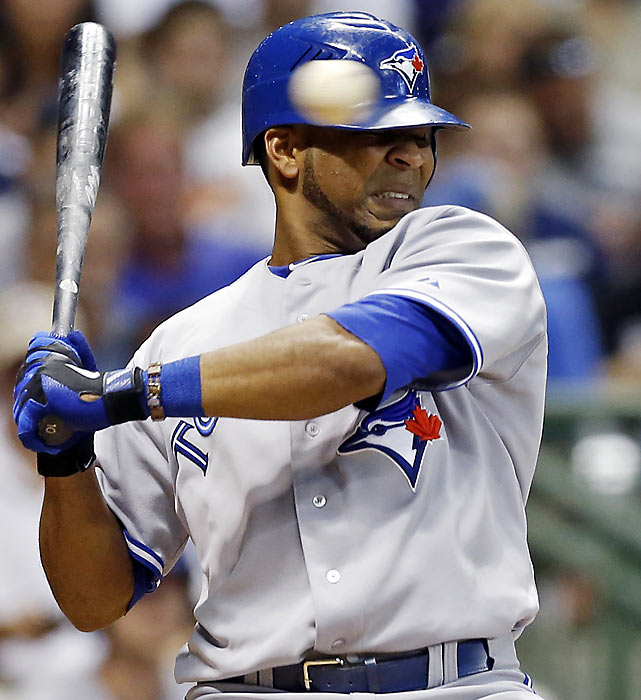 Edwin Encarnacion of the Blue Jays shies away from a Tyler Thornburg pitch during a game against the Milwaukee Brewers.
