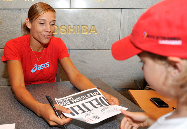 Jones signs autographs at the Olympic Museum in Switzerland. She competed in the Athletissima 100m hurdles a few days later, finishing in eighth.