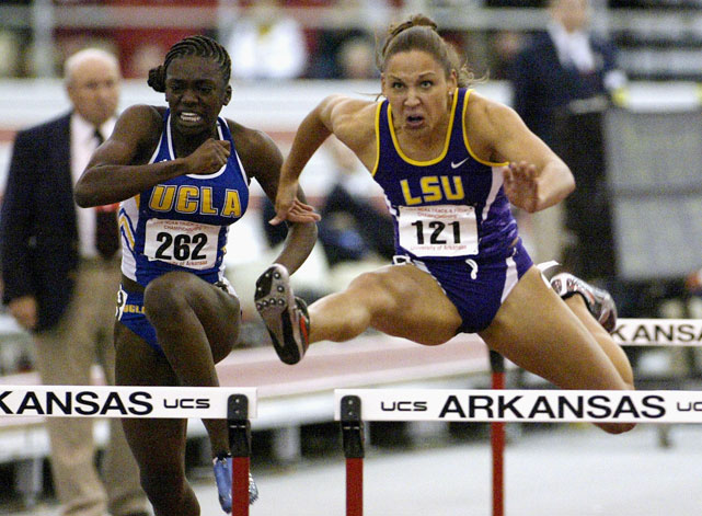 Jones clears in the 60-meter hurdles during the NCAA Indoor Track and Field Championships as UCLA's Dawn Harper follows close behind. With a time of 8.12 seconds, Jones came in second.