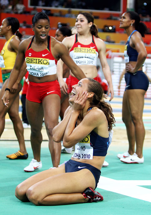 Jones celebrates her gold medal in the 60m hurdles at the IAAF World Indoor Championships.