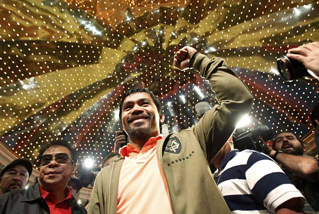 Both Pacquiao and Bradley made their grand arrivals Tuesday in the lobby of the MGM Grand Hotel in advance of Saturday's welterweight championship fight.