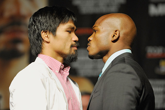 Pacquiao and Bradley pose during Wednesday's final news conference ahead of Saturday's welterweight title fight at the MGM Grand Garden Arena in Las Vegas.