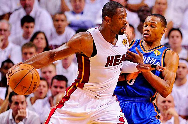 Dwyane Wade tries to bull his way through Russell Westbrook en route to the Heat taking a two games to one lead over the Thunder in the NBA Finals. Here are SI's best shots from the game.