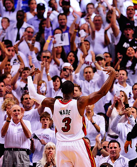 Dwyane Wade works the Miami crowd as the Heat pursue what would be their first title with LeBron James in South Beach.