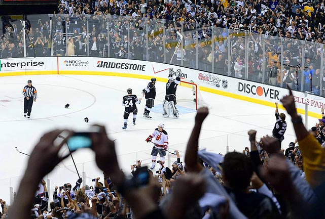 Netminder Jonathan Quick finished his postseason MVP performance with 17 saves, and the Kings became the first eighth-seeded playoff team to win the Stanley Cup finals.