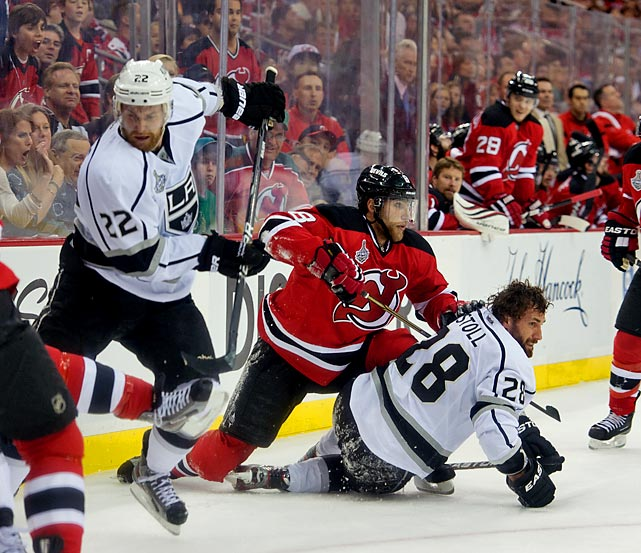 Kings forward Jarret Stoll lost his helmet after a tussle along with boards with Devils Dainius Zubrus.
