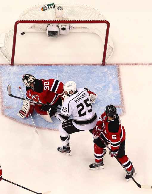 Devils goalie Martin Brodeur looks in vain as the winning shot by Jeff Carter (not pictured) goes in.
