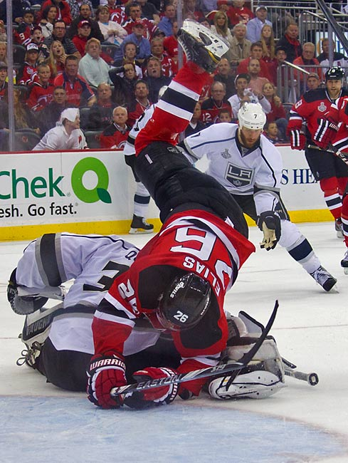 Despite his best efforts to avoid a collision, Devils forward Patrik Elias flips over Kings goalie Jonathan Quick in the third period.