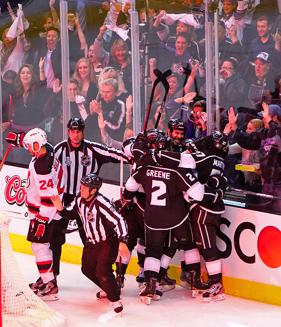 Dwight King (center) was all smiles after getting the primary assist on a second-period score.