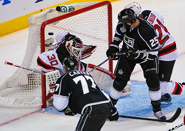 Jeff Carter's shot sails over Martin Brodeur's shoulder to widen the Kings lead to 3-0 in the third period.
