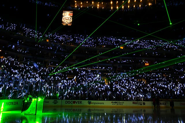The Staples Center was illuminated by lasers and fans holding glow sticks prior to the start of Game 3.