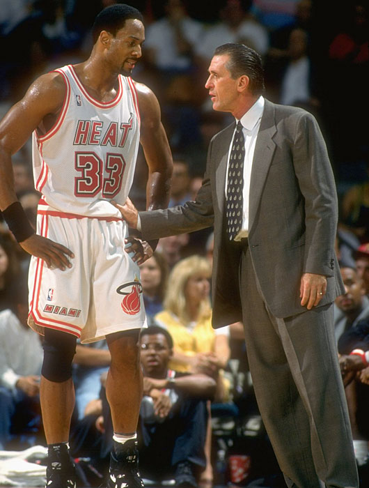 Riley talks on the sidelines with Alonzo Mourning. Mourning finished the season with 24 points and 10 rebounds per game, but the Heat would be swept out of the first round by Chicago.