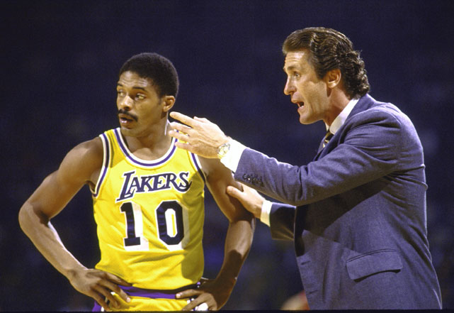 Riley gives instructions to point guard Norm Nixon during the 1983 NBA Playoffs. A slick passer with a soft shooting touch, Nixon averaged over 17 points and eight assists per game between 1978 and 1983 as a member of the Lakers.