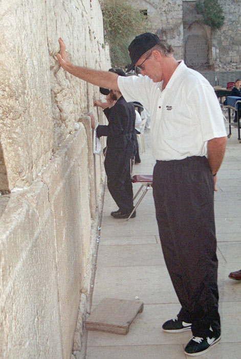 Riley touches the Western Wall in Jerusalem, Judaism's most holy site. The Heat traveled to Israel in October 1999 for an exhibition against Maccabe Tel Aviv.