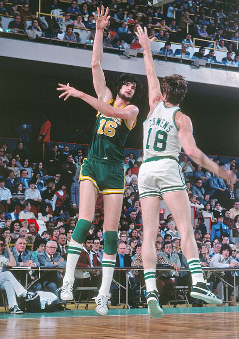 Center Tom Burleson shoots against Celtics center Dave Cowens during a 1976 game. Burleson was the third overall pick for the 1974 NBA draft, the same year he led North Carolina State to a memorable NCAA championship victory.