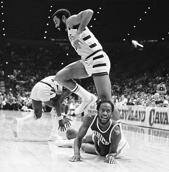 Gus Williams waits for the referee's call after being fouled by Walt Frazier. Williams started playing for the Seattle SuperSonics in the 1977-1978 season and led his team to the 1979 championship.