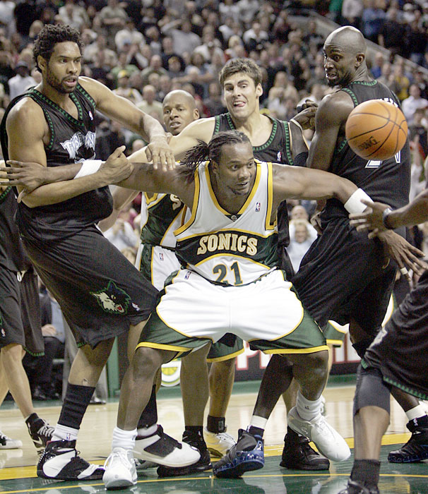 Danny Fortson overpowers Michael Olowokandi, Wally Szcerbiak and Kevin Garnett during the fourth quarter of a 2004 Sonics-Timberwolves game. During the 2004-2005 season, Fortson registered the second-highest total for technical fouls among active NBA players.