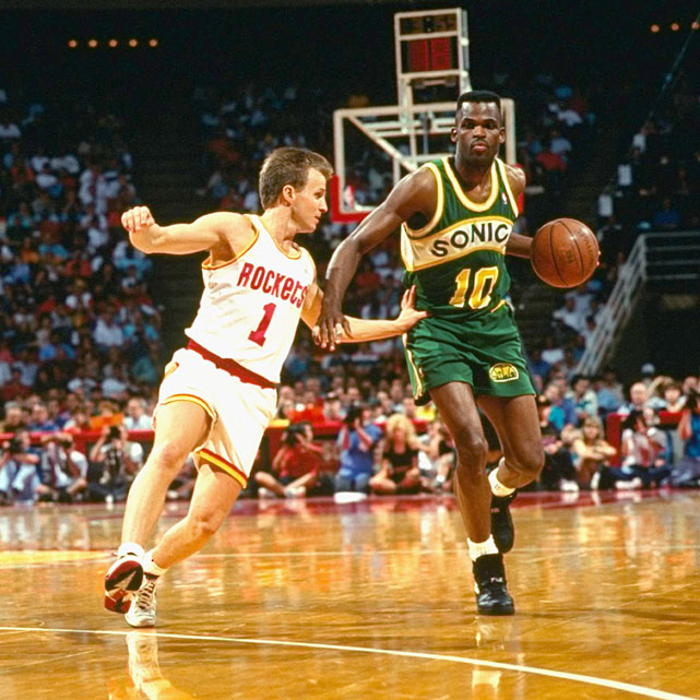 Nate McMillan drives on Scott Brooks during a 1993 playoff game between the Spurs and Rockets. McMillan spent all 12 years of his playing career in Seattle and coached the team for five seasons from 2000-05.