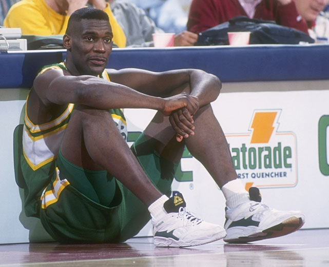 It wasn't often that Shawn Kemp was sitting down in his time in a Seattle uniform. Perhaps the highest flyer of them all, Kemp was a superb athlete known for his ferocious slam dunks and animated facial expressions. In six seasons ranging from 1991-1997, Kemp averaged at least 15 points and 10 rebounds per game and established himself as one of the league's most powerful big men. After the Sonics shockingly signed the unheralded Jim McIlvaine to a seven-year $35 million contract instead of Kemp, the outraged star would soon be traded to Cleveland in a blockbuster three-team deal that brought Baker to Seattle and effectively derailed his career.