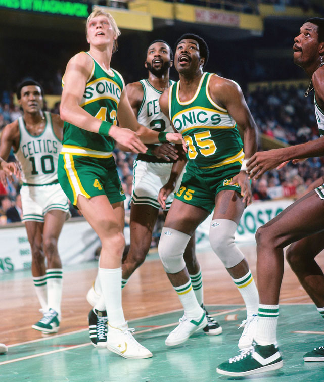 Jack Sikma and Paul Silas look to rebound against the Boston Celtics during a 1978 game. Both players collected more than 10,000 rebounds during their careers. Sikma and Silas were also both players during the 1988-1989 season when the Sonics won the NBA Championship.