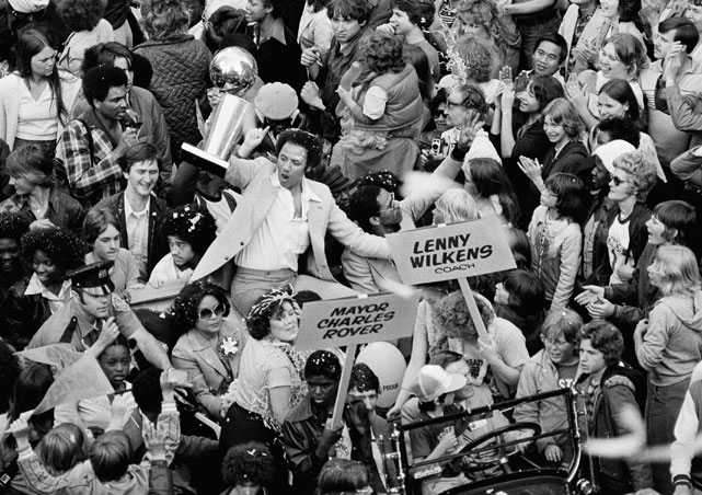 SuperSonics Coach Lenny Wilkens raises the NBA World Championship trophy amongst thousands of fans in celebration of their victory over the Washington Bullets on June 4, 1979. Wilkens was the only coach to ever lead the Sonics to an NBA Championship victory.