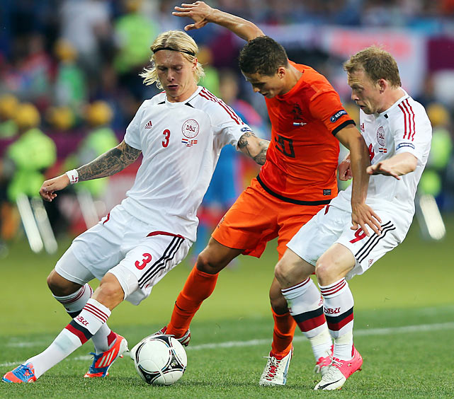 In the upset of the tournament thus far, the Danes used an early strike from Michael Krohn-Dehli to shock the World Cup finalists. It was a wide-open affair that saw the Dutch attempt 28 shots, but only eight were on frame and none could beat Danish keeper Stephan Andersen.