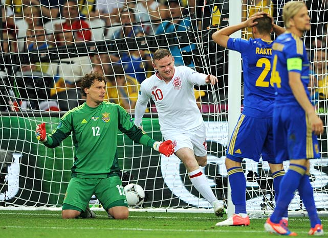 Wayne Rooney scored the game's lone goal in his return from a two-game suspension and England won Group D with a 1-0 defeat of Ukraine. While the co-hosts appeared to be the better technical side, coach Oleg Blokhin's team could not find its way past Joe Hart -- at least officially.  Marko Devic appeared to finish a promising chance off of a counter-attack, but the fifth official ruled that the shot did not cross the line. Though very close, replays showed the ball over the line. England will move on to play Italy in the quarterfinals.