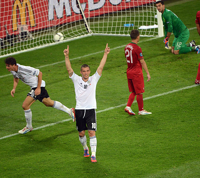 "It was a rather dreary affair from two usually exciting squads, but the Germans rose to the top of the ""Group of Death"" after a 72' minute header from forward Mario Gomez. The typically efficient Germans controlled the midfield, anchored predominantly by Mesut Ozil, who, along with countryman Sami Khedira, was facing off against Real Madrid teammates Cristiano Ronaldo, Pepe and Fabio Coentrao."